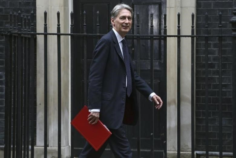 Britain's Chancellor of the Exchequer Philip Hammond arrives for a meeting of the ''Cabinet Committee on Economy and Industrial Strategy'' at Number 10 Downing Street in London, Britain August 2, 2016.