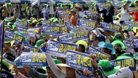 Seongju residents chant slogans during a protest against the government's decision to place a U.S. Terminal High Altitude Area Defence (THAAD) anti-missile defence unit in their town, in Seongju, South Korea, August 15, 2016. The banners read, 'Desperately oppose the deployment of THAAD'.