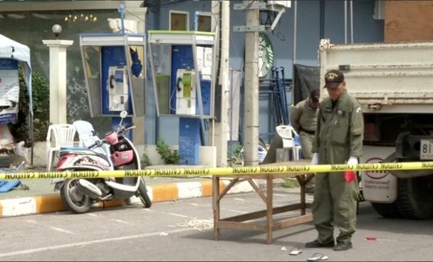 Police Explosive Ordnance Disposal (EOD) official inspects the site of a bomb blast in Hua Hin, south of Bangkok, Thailand, in this still image taken from video August 12, 2016.
