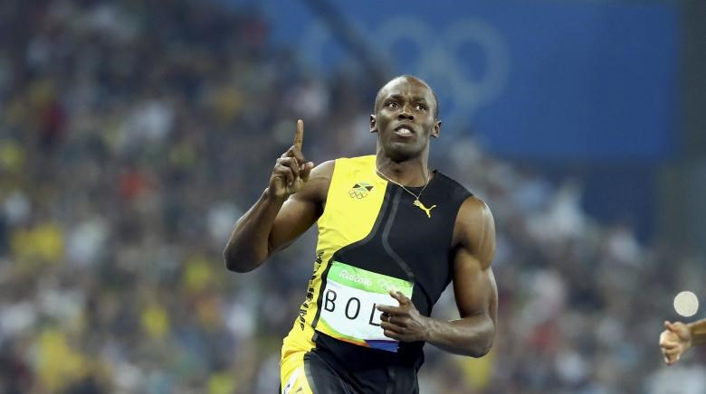 Usain Bolt celebrates winning the gold medal.