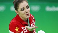 Aliya Mustafina (RUS) of Russia celebrates winning the gold.
