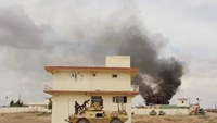 Smoke billows from a building after a Taliban attack in Gereshk district of Helmand province, Afghanistan March 9, 2016.