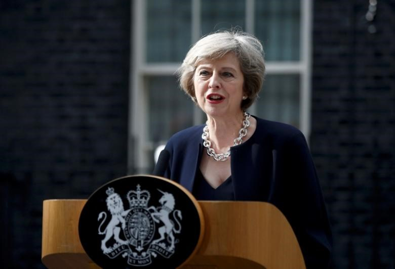 Britain's Prime Minister, Theresa May, speaks to the media outside number 10 Downing Street, in central London, Britain July 13, 2016.