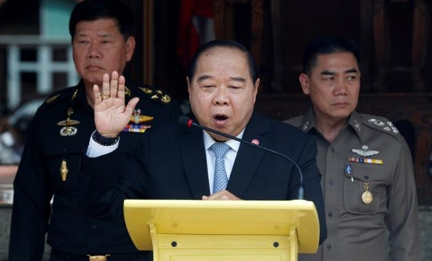 Thailand's Deputy Prime Minister and Defence Minister Prawit Wongsuwan (C) speaks during a news conference after a National Security Council meeting as Thailand's national police chief Jakthip Chaijinda (R) and The Commander-in-Chief of the Royal Thai Army, Teerachai Nakwanich listen at Government House in Bangkok, Thailand, August 15, 2016.