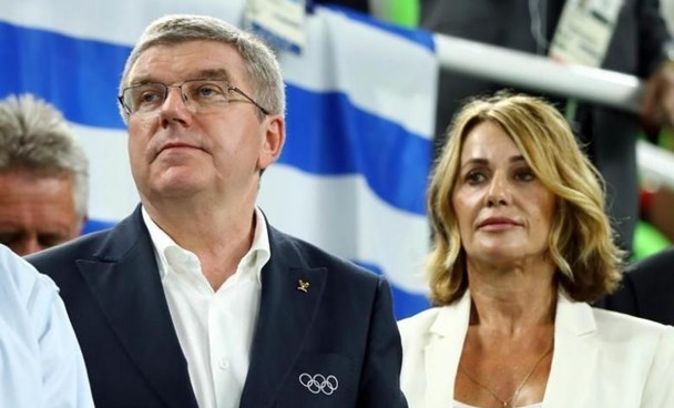President of the International Olympic Committee (IOC) Thomas Bach and former Romanian gymnast Nadia Comaneci are seen.