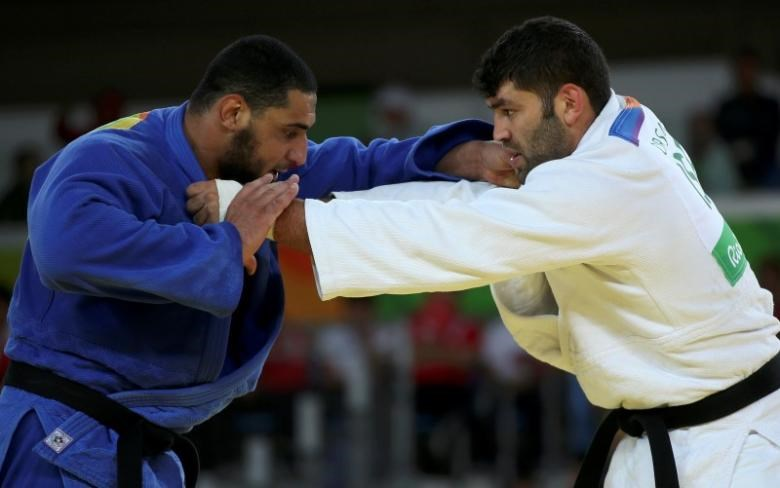 Or Sasson (ISR) of Israel and Islam El Shehaby (EGY) of Egypt compete.