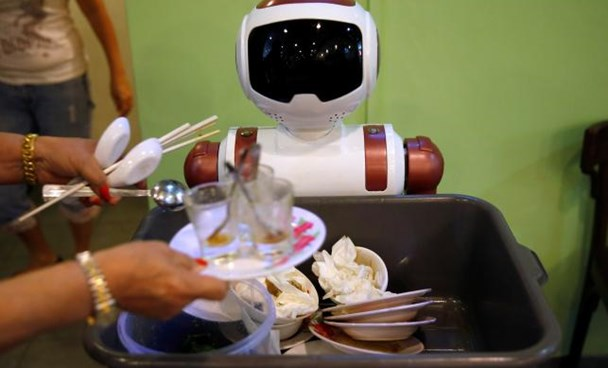 A robot collects dishes to be cleaned at Chilli Padi Nonya Cafe in Singapore July 6, 2016. Picture taken July 6, 2016.