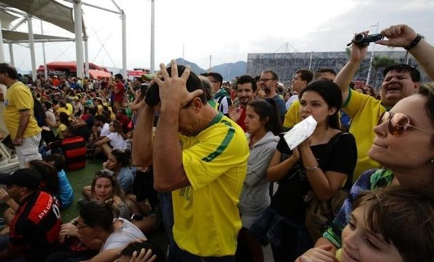 A man reacts as the Brazilian women's soccer team misses a penalty against Sweden as the match was shown on a big screen in the Olympic Park.