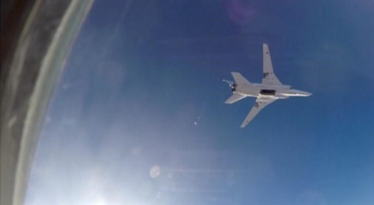 A still image, taken from video footage and released by Russia's Defence Ministry on August 16, 2016, shows a Russian Tupolev Tu-22M3 long-range bomber based in Iran, flying after bombs were dropped off, at an unknown location in Syria. Ministry of Defence