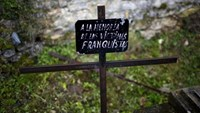 A cross with a sign that reads 'To the memory of Franco era victims' is seen at the cemetery of Valdenoceda, near Burgos, northern Spain, April 16, 2016.