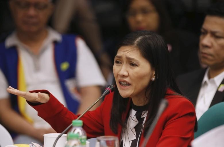Maia Santos Deguito, a branch manager of the Rizal Commercial Banking Corp (RCBC) gestures as she testifies during a Senate hearing of money laundering involving $81 million stolen from Bangladesh's central bank, at the Philippine Senate in Manila April 19, 2016.