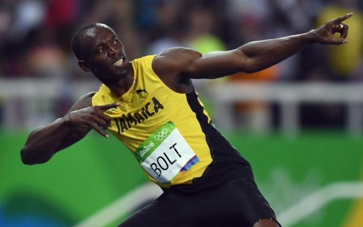 Usain Bolt (JAM) of Jamaica celebrates after winning gold