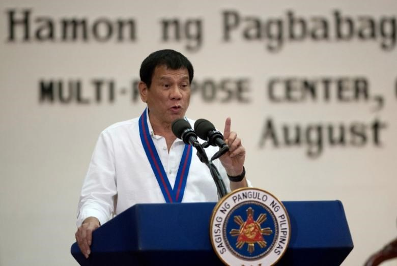 Philippine President Rodrigo Duterte gestures while delivering a speech during the 115th Police Service Anniversary at the Philippine National Police (PNP) headquarters in Quezon city, metro Manila, Philippines August 17, 2016.