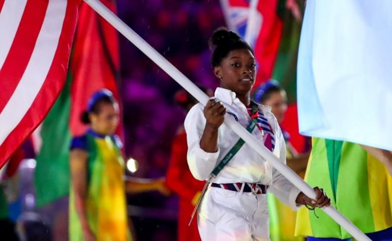 Simone Biles (USA) carries the flag during the closing ceremonies for the Rio 2016 Summer Olympic Games at Maracana. Mandatory Credit: Rob Schumacher-USA TODAY Sports