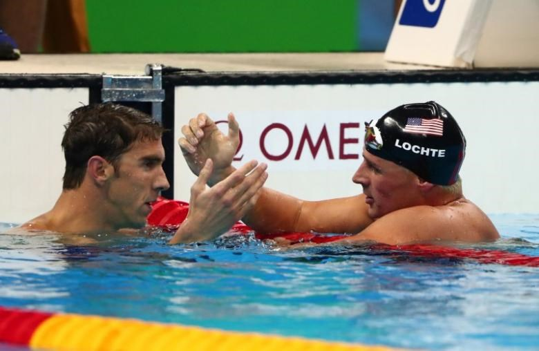 Michael Phelps (USA) and Ryan Lochte (USA) react after the men's 200m individual medley final in the Rio 2016 Summer Olympic Games at Olympic Aquatics Stadium. Mandatory Credit: Rob Schumacher-USA TODAY Sports