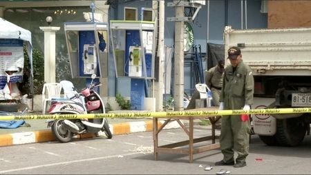 Police Explosive Ordnance Disposal (EOD) official inspects the site of a bomb blast in Hua Hin, south of Bangkok