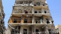 A view shows a damaged building in Tariq al-Bab neighborhood of Aleppo, Syria, August 22, 2016.