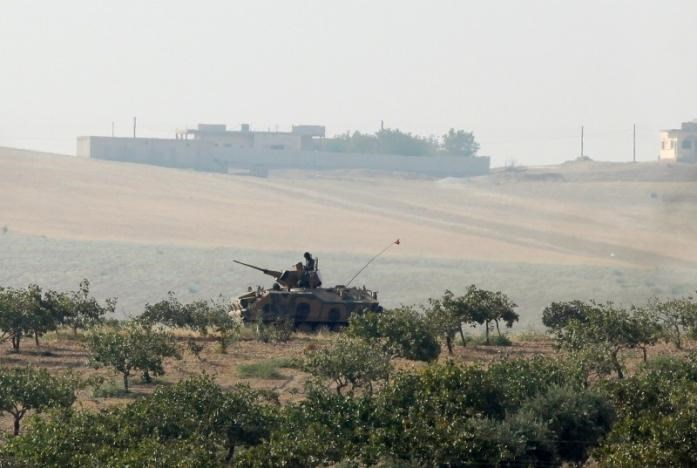 A Turkish army armoured vehicle is pictured in Karkamis on the Turkish-Syrian border in the southeastern Gaziantep province, Turkey.