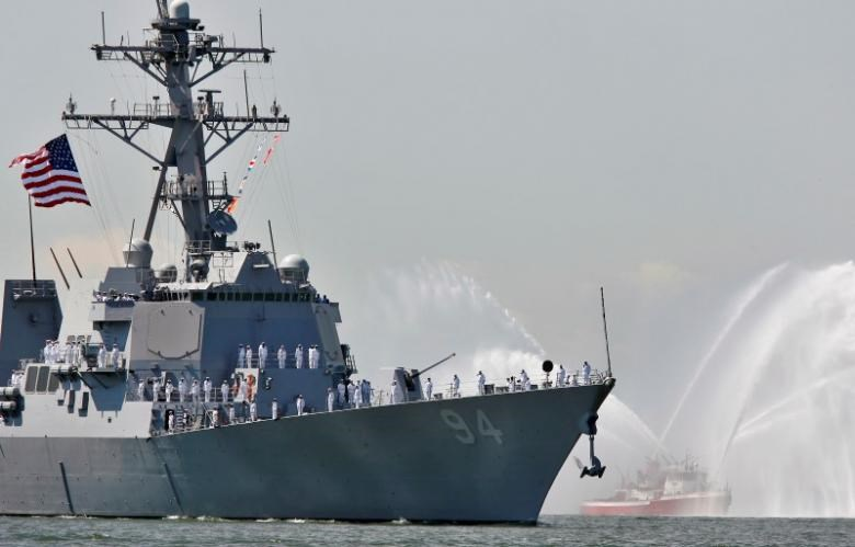 The USS Nitze, a Guided Missile Destroyer is greeted by the spray of a fireboat to kick off Fleet Week in New York Harbor, May 24, 2006. Fleet Week will run through May 30, featuring extensive naval and military display for the public.