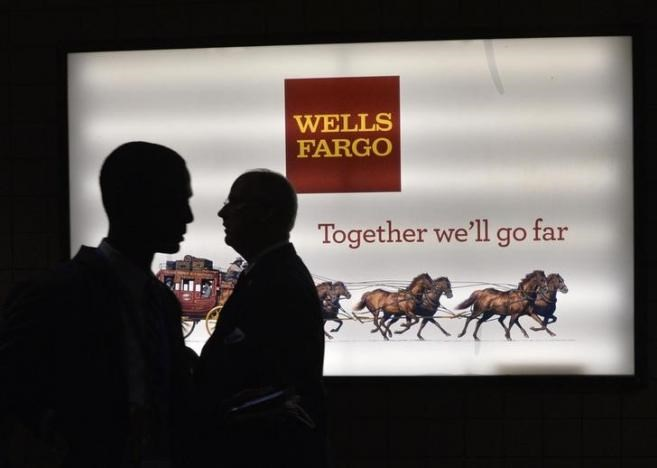 Men pass a sign at Wells Fargo Center at the Democratic National Convention in Philadelphia, Pennsylvania, U.S. July 25, 2016