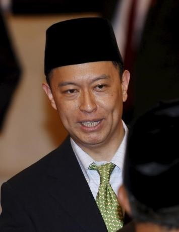 Indonesia's new Minister of Trade Thomas Lembong is seen before taking the oath at the presidential palace in Jakarta, Indonesia August 12, 2015.