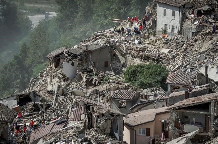 Rescuers work following an earthquake in Pescara del Tronto, central Italy, August 24, 2016.