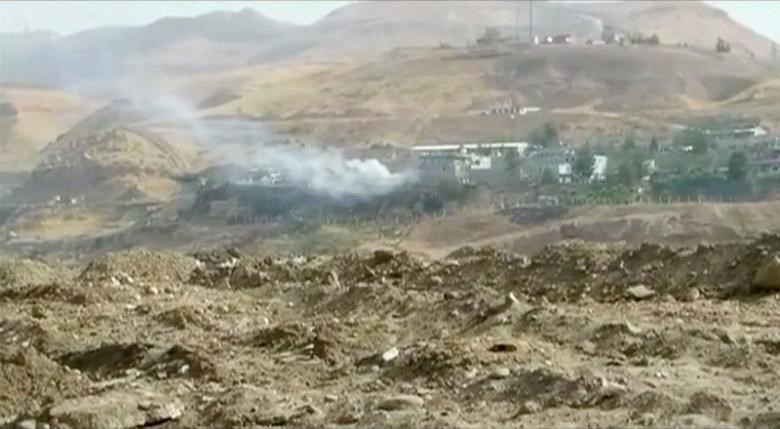 Smoke rises from buildings at the site of a car bomb explosion at a police headquarters in Cizre, located in Turkey's Sirnak province bordering both Syria and Iraq, in this still image from video August 26, 2016.