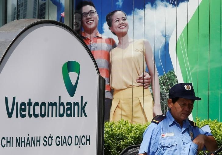A security guards outside a branch office of Vietcombank in Hanoi, Vietnam