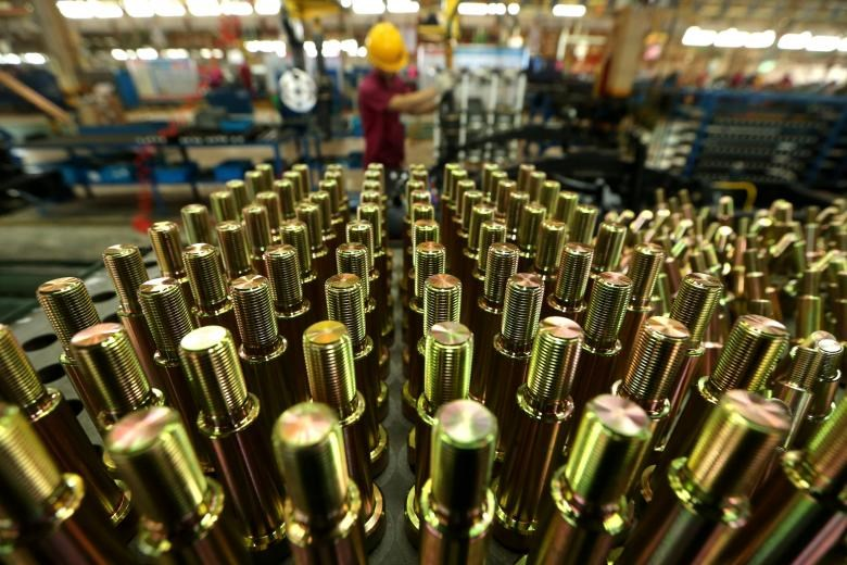 An employee works in an automobile factory in Nantong, Jiangsu Province, China, July 8, 2016. China Daily/via REUTERS/File Photo