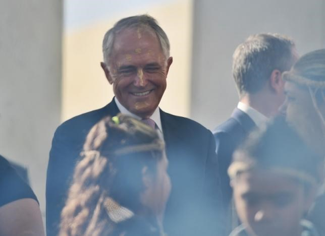Australian Prime Minister Malcolm Turnbull participates in a traditional smoking ceremony marking the start of Australia's new Parliament session at Parliament House in Canberra, August 30, 2016. AAP/Mick Tsikas/via REUTERS