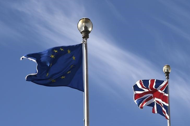 A British Union flag and an European Union flag are seen flying above offices in London, Britain, March 30, 2016.