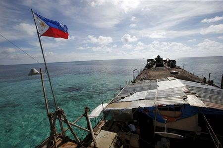 A Philippine flag flutters from BRP Sierra Madre, a dilapidated Philippine Navy ship that has been aground since 1999 and became a Philippine military detachment on the disputed Second Thomas Shoal