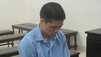 Chinese national Tang Yuan Xun is tried on robbery charge in Hanoi Monday