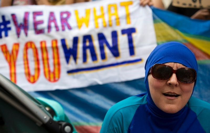A woman wearing a burkini joins a protest outside the French embassy in London on August 25, 2016 against the banning of the Islamic swimwear on some French beaches