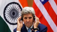 U.S. Secretary of State John Kerry adjusts his ear phones during a joint news conference with India's External Affairs Minister Sushma Swaraj (not pictured) in New Delhi, India, August 30, 2016.