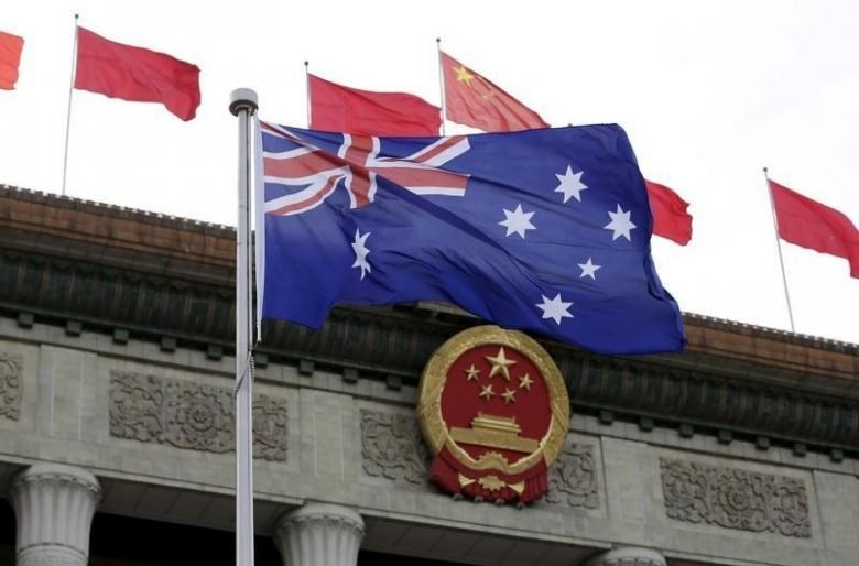 Australian flag flutters in front of the Great Hall of the People during a welcoming ceremony for Australian Prime Minister Malcolm Turnbull (not in picture) in Beijing, China, April 14, 2016.
