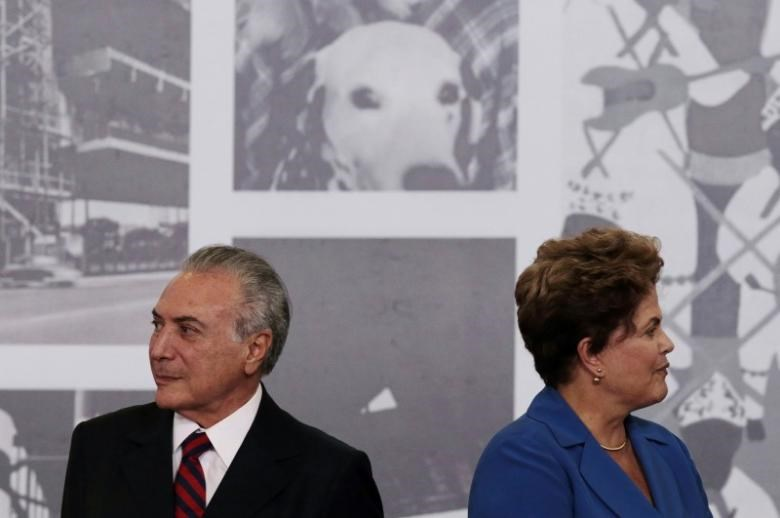 Brazil's President Dilma Rousseff is seen next to Vice President Michel Temer during the Order of Cultural Merit ceremony at the Planalto Palace in Brasilia November 5, 2014. REUTERS/Ueslei Marcelino/File Photo