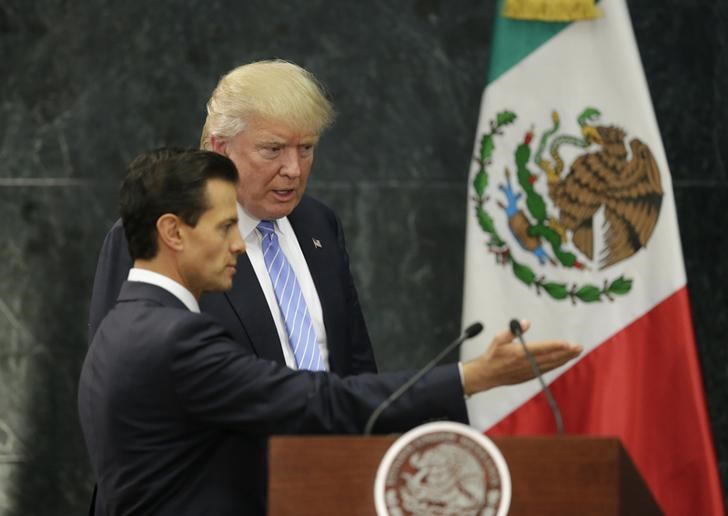 Mexico contradicts Trump on paying for border wall, clouding visit