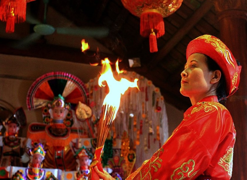 Vietnamese shaman dance practioners promise to rid followers of evil spirits by using music to lure them out