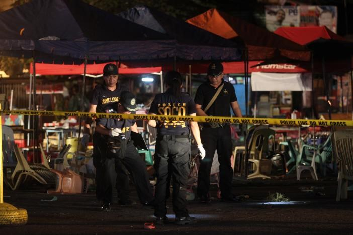 Police investigators inspect the area of a market where an explosion happened in Davao City, Philippines September 2, 2016.