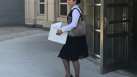 Former Air China employee Ying Lin exits the building after a pretrial hearing in federal court in Brooklyn, New York, U.S. on June 21, 2016. Picture taken June 21, 2016.
