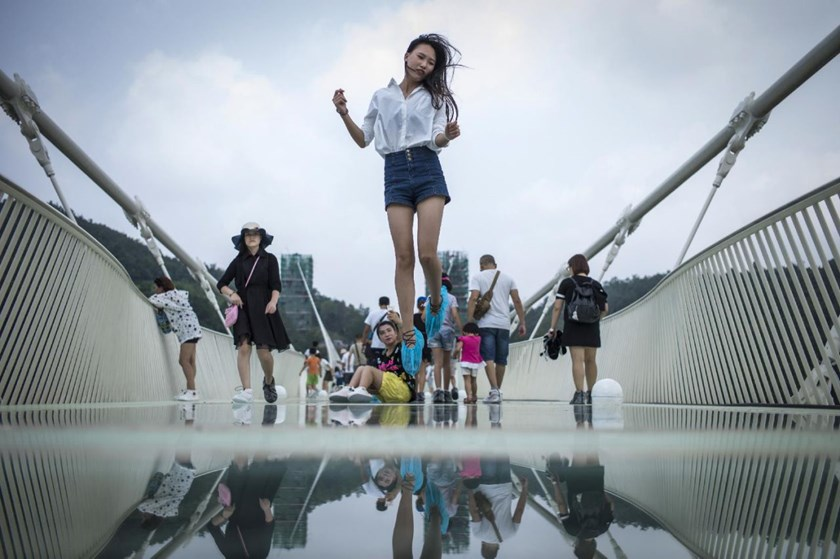 The glass-bottomed bridge over Zhangjiajie Grand Canyon