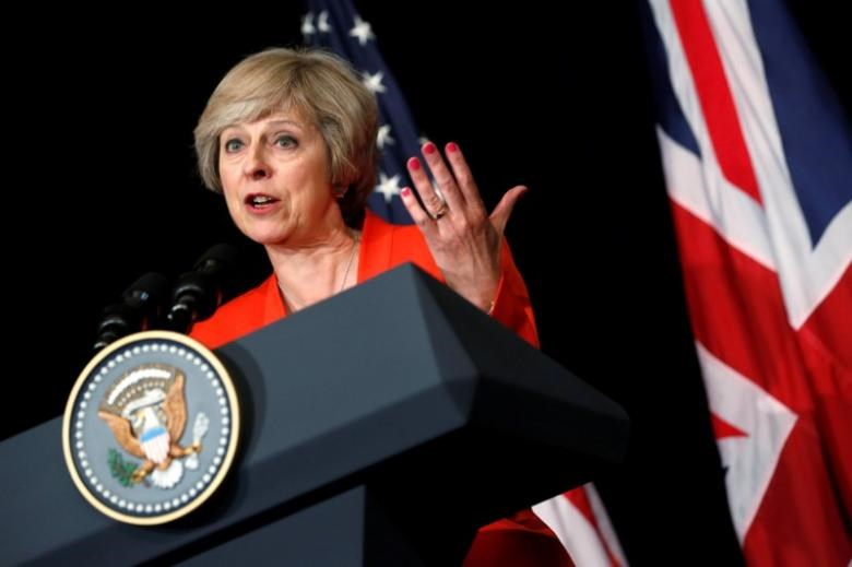 Britain's Prime Minister Theresa May answers a reporter's question after a bilateral meeting with U.S. President Barack Obama alongside the G20 Summit, in Ming Yuan Hall at Westlake Statehouse in Hangzhou, China September 4, 2016.