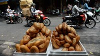 'Banh mi' are displayed for sale on a sidewalk in central Hanoi