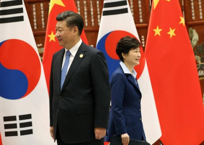 South Korean President Park Geun-hye (R) walks past Chinese President Xi Jinping during their meeting on the sidelines of the G20 Summit at the West Lake State Guest House in Hangzhou, China, September 5, 2016.
