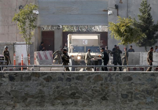 Afghan security forces inspect at the site of a suicide attack in Kabul, Afghanistan September 5, 2016.