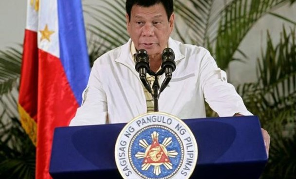 Philippines' President Rodrigo Duterte delivers his pre-departure message before leaving for the Association of Southeast Asian Nations (ASEAN) Summit in Laos at the Davao International Airport in Davao city, Philippines September 5, 2016