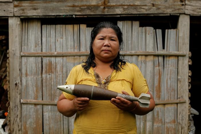 Toui Bounmy Sidavong, 43, holds a bomb dropped by the U.S. Air Force planes during the Vietnam War, in the village of Ban Napia in Xieng Khouang province, Laos September 3, 2016.