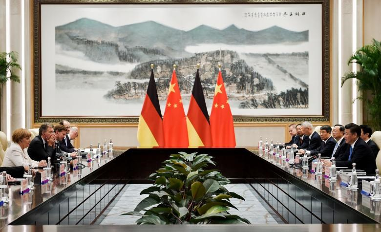 Chinese President Xi Jinping (R) and German Chancellor Angela Merkel (L) during their meeting at the West Lake State House on the sidelines of the G20 Summit, in Hangzhou, Zhejiang province, China, September 5, 2016.