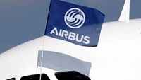 A flight test engineer holds an Airbus Group flag after the first flight of the Airbus A320neo (New Engine Option) in Colomiers near Toulouse, France, September 25, 2014.